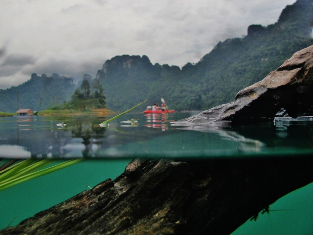 Paddling in the fresh water of the Koa Sok national park. Thailand. Photo: Reece